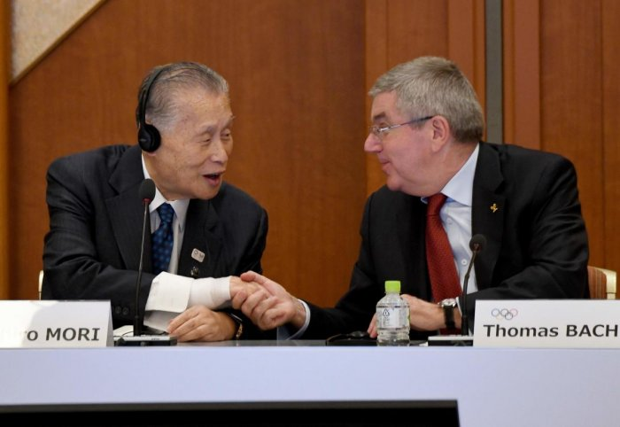 International Olympic Committee (IOC) president Thomas Bach (R) shakes hands with Tokyo 2020 president Yoshiro Mori (L) during the opening plenary session of the IOC Coordination Commission in Tokyo. AFP