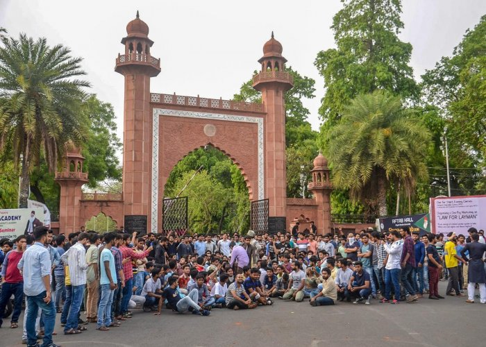 Aligarh Muslim University students protest at the gate of the university campus in Aligarh. (PTI File Photo)