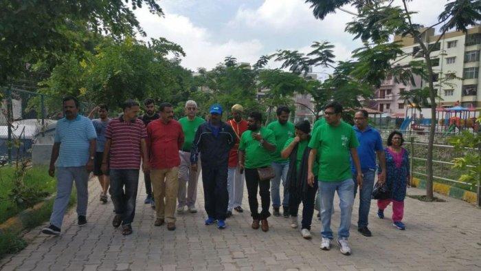 Mayor R Sampath Raj, along with the local residents, visits the Kaggadasapura Lake on Sunday.