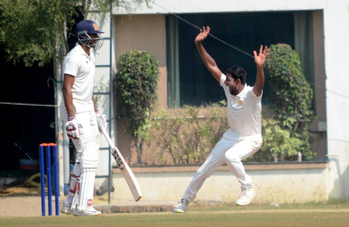 POSITIVE START: Karnataka's J Suchith (right) bagged a five-wicket haul in the second innings to finish with nine scalps in the game against Vidarbha. DH PHOTO