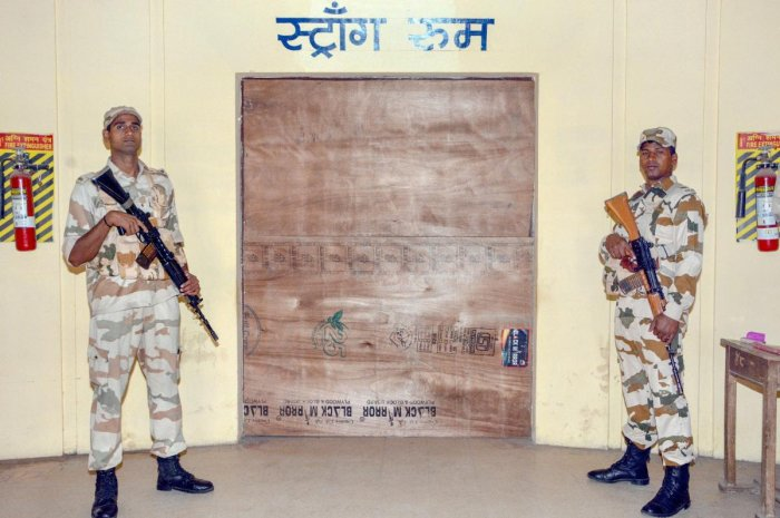 Indo Tibetan Border Police Force jawans guard outside a strong room where Electronic Voting Machines (EVM) are kept, Madhya Pradesh Assembly elections, in Jabalpur, Thursday, Nov 29, 2018. (PTI Photo)