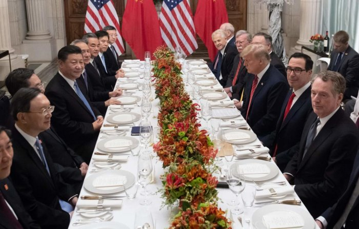 US President Donald Trump and China's President Xi Jinping along with members of their delegations, hold a dinner meeting at the end of the G20 Leaders' Summit in Buenos Aires. AFP file photo.