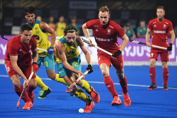 FINDING A WAY THROUGH: Australia's Flynn Ogilvie (centre) attempts to dribble past England players during their pool game on Tuesday. AFP