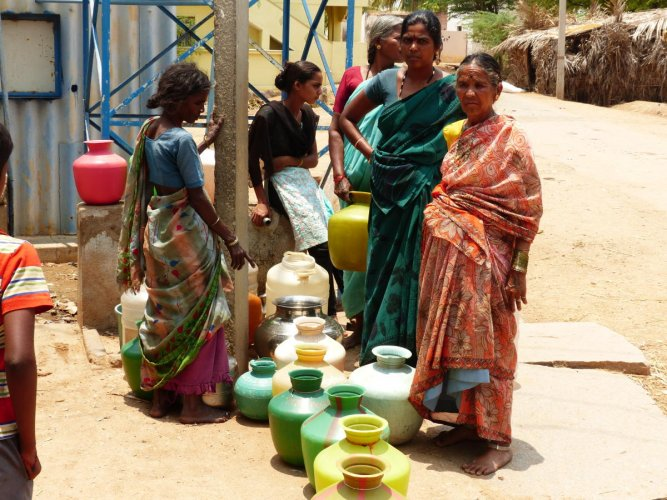 Women waiting to collect fluoridated water from a de-fluoridation plant in Pavagada taluk. Only two to three of the nearly 18 such plants (each installed at a cost of Rs 10.50 lakh) are functioning, according to a study by Team Fluoride. DH PHOTO