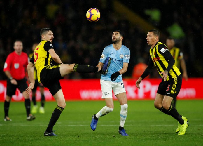 Watford's Craig Cathcart in action with Manchester City's Riyad Mahrez. (Reuters)