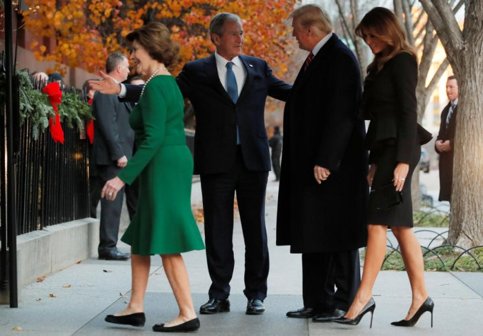 On a chilly afternoon, former president George W. Bush, son of the deceased elder Bush, greeted Trump and the first lady, Melania, outside Blair House and took them inside for a private visit. (Reuters photo)