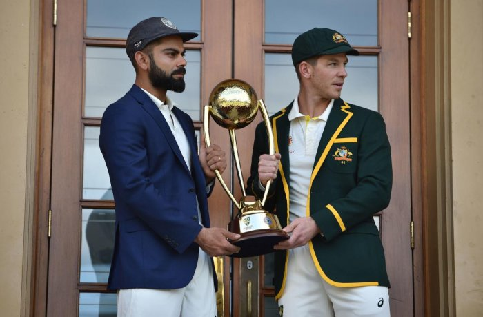 Australia cricket captain Tim Paine (R) and India cricket captain Virat Kohli (L) pose with the Border Gavaskar trophy ahead of the first Test at the Adelaide Oval in Adelaide on December 5, 2018. (AFP Photo)