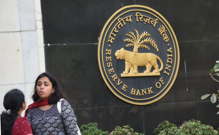 The RBI said it would reduce SLR by 25 basis points every quarter starting next month till it reached 18%. AFP Photo