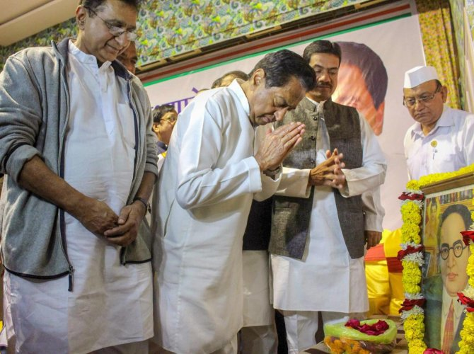 Congress State President Kamal Nath pays tribute to Bhimrao Ambedkar on his death anniversary, during a meeting of 230 Congress party candidates contesting for state Assembly election, in Bhopal, on Thursday. PTI