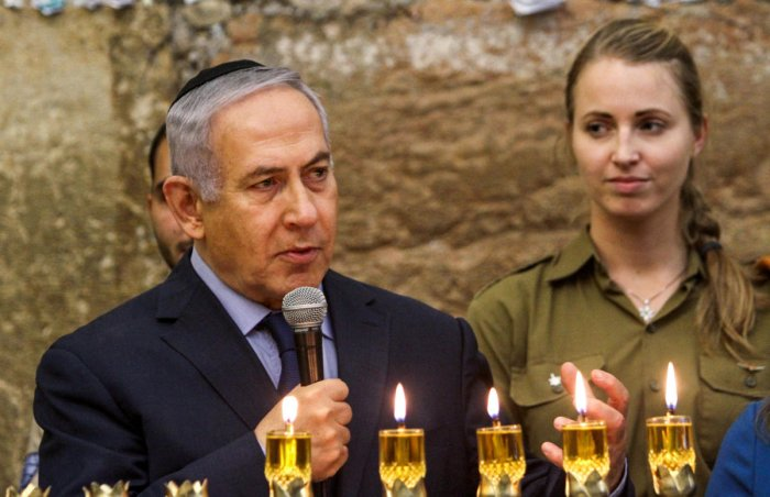 Benjamin Netanyahu speaks during a candle lightning ceremony on the Jewish holiday of Hanukkah at the Western Wall in Jerusalem's Old City. Reuters