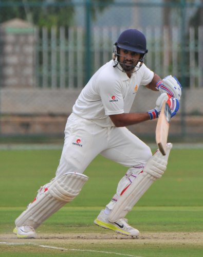 BATTLING: Karnataka's Karun Nair top scored with 63 against Saurashtra on the second day of their Ranji Trophy tie in Rajkot on Friday. DH FILE PHOTO