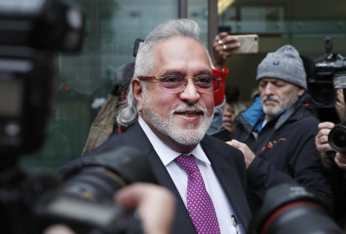 """""""I left India because I had a scheduled meeting in Geneva. Before leaving I met the finance minister and offered to settle (the issue with the banks), Mallya said, without naming the minister. (AP/PTI Photo)"""