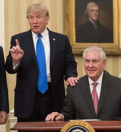 (FILES) In this file photo taken on February 1, 2017, US President Donald Trump (L) speaks after Rex Tillerson was sworn in as Secretary of State in the Oval Office at the White House in Washington, DC. - Trump on December 7, 2018, called his former secre