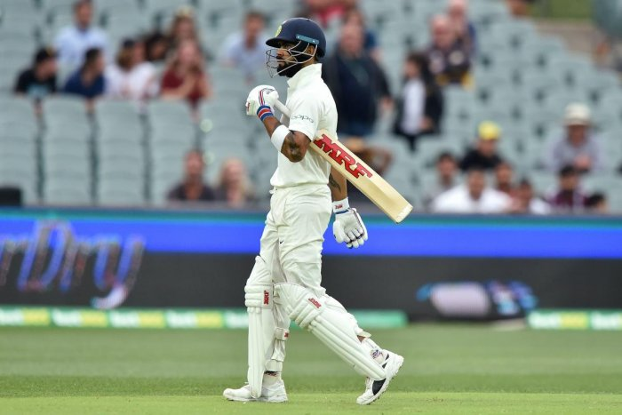Virat Kohli walks after Australia took his wicket during day three of the first Test cricket match at the Adelaide Oval on December 8, 2018. Credit: AFP Photo/Peter Parks