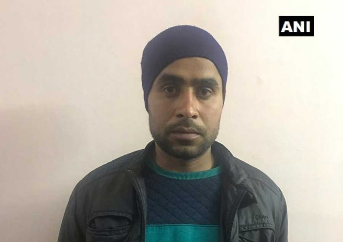 The Army handed over Jitendra Malik to Uttar Pradesh Special Task Force team in Meerut late Saturday night. Image courtesy ANI/Twitter