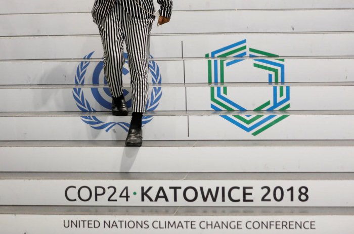 A woman walks down the stairs inside the venue of the COP24 U.N. Climate Change Conference 2018 in Katowice, Poland December 4, 2018. REUTERS/Kacper Pempel