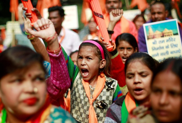 "People shout slogans during a demonstration organised by the Hindu hardline group ""United Hindu Front"" to mark the 26th anniversary of the razing of a 16th century Babri mosque by a Hindu mob in the town of Ayodhya, in New Delhi (Reuters)"