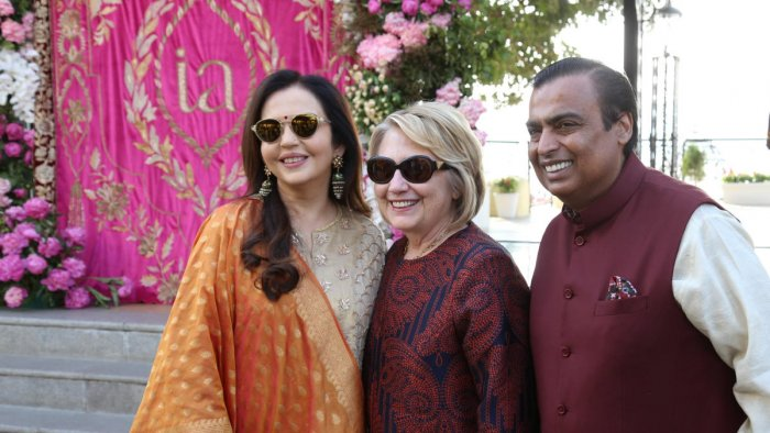Former U.S. Secretary of State Hillary Clinton poses with Mukesh Ambani, Chairman of Reliance Industries, and his wife Nita Ambani after her arrival in Udaipur to attend pre-wedding celebrations of their daughter Isha Ambani in the desert state of Rajasth