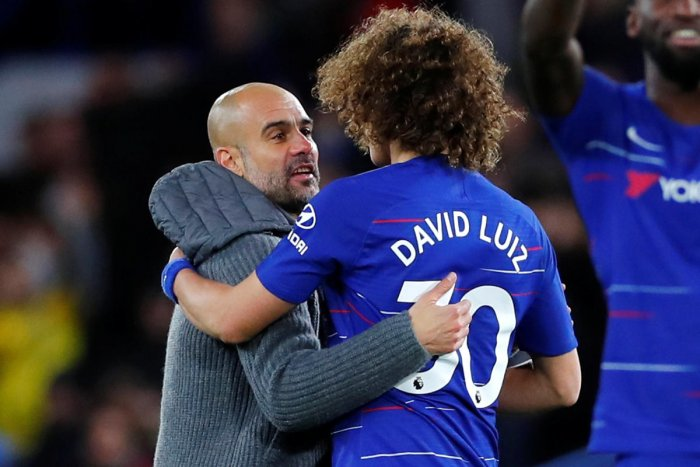 Soccer Football - Premier League - Chelsea v Manchester City - Stamford Bridge, London, Britain - December 8, 2018 Manchester City manager Pep Guardiola and Chelsea's David Luiz after the match REUTERS/Eddie Keogh EDITORIAL USE ONLY. No use with unauthori