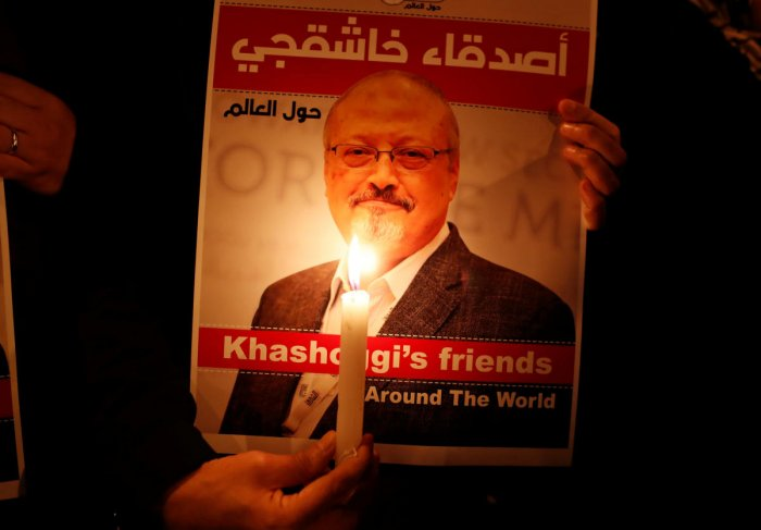 A demonstrator holds a poster with a picture of Saudi journalist Jamal Khashoggi outside the Saudi Arabia consulate in Istanbul, Turkey. (Reuters File Photo)