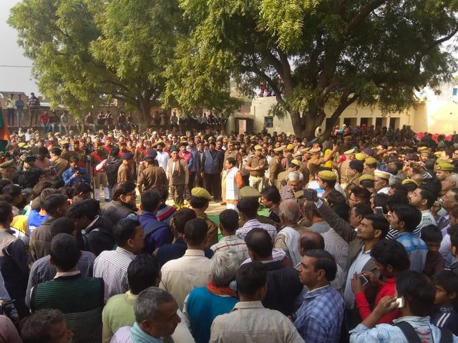 People gather to pay their last respects to Police Inspector Subodh Kumar Singh, during his funeral ceremony in Etah on December 04, 2018. Singh was killed during violent clashes that erupted over the reported illegal slaughter of cattle, in Bulandshahr.