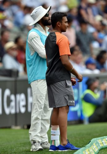 ON THE ROAD TO RECOVERY Prithvi Shaw (right) watches the action of the opening Test at Adelaide with team-mate Ravindra Jadeja. AFP