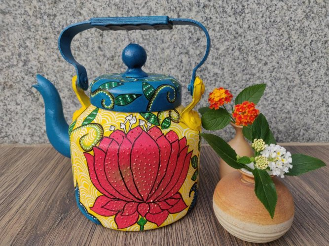 Rachana uses decoupage to decorate kettles, purses and chopping boards.