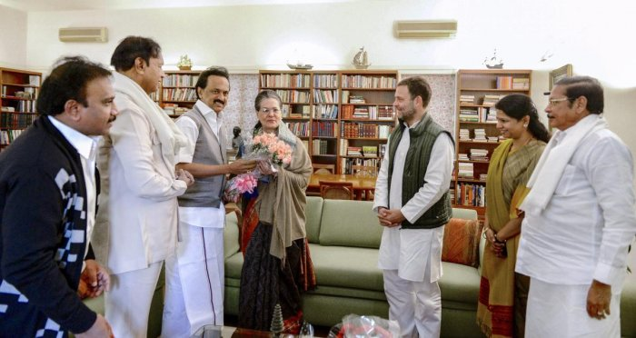 DMK President MK Stalin offers a bouquet to former Congress president Sonia Gandhi on the occasion of her birth anniversary, in New Delhi. Also seen are Congress President Rahul Gandhi, DMK leaders Kanimozhi, A Raja and others. (PTI Photo)