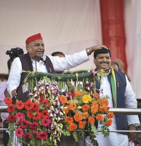 Samajwadi Party founder Mulayam Singh Yadav and Pragatisheel Samajwadi Party-Lohia (PSP-L) chief Shivpal Singh Yadav attend 'Janakrosh Maharally', in Lucknow, on Sunday. PTI