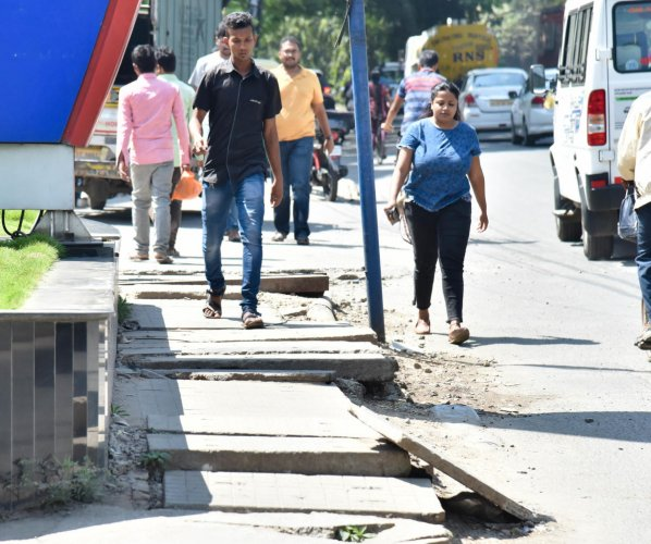 BBMP officials cited lack of funds and said the work on footpaths may not take off. DHPhoto/Janardhan B K