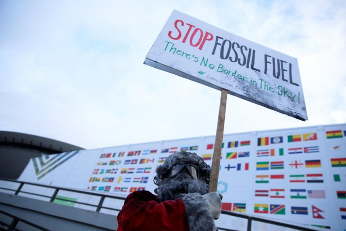 Environmental activist protests against fossil fuel in front of the the venue of the COP24 UN Climate Change Conference 2018 in Katowice, Poland December 10, 2018. Agencja Gazeta/Grzegorz Celejewski via REUTERS ATTENTION EDITORS - THIS IMAGE WAS PROVIDED