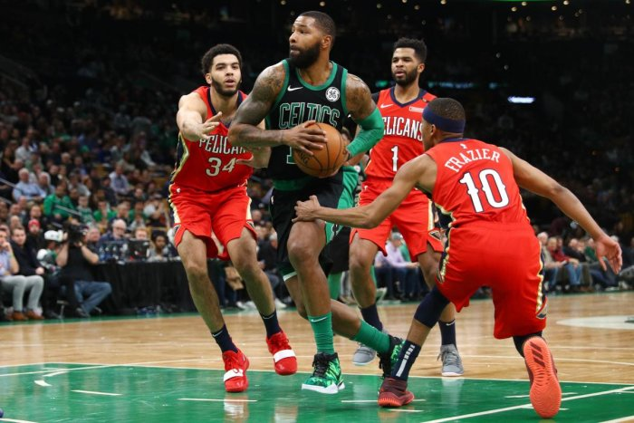 BOSTON, MA - DECEMBER 10: Kenrich Williams #34 of the New Orleans Pelicans and Tim Frazier #10 defend Marcus Morris #13 of the Boston Celtics at TD Garden on December 10, 2018 in Boston, Massachusetts. Maddie Meyer/Getty Images/AFP == FOR NEWSPAPERS, INTE