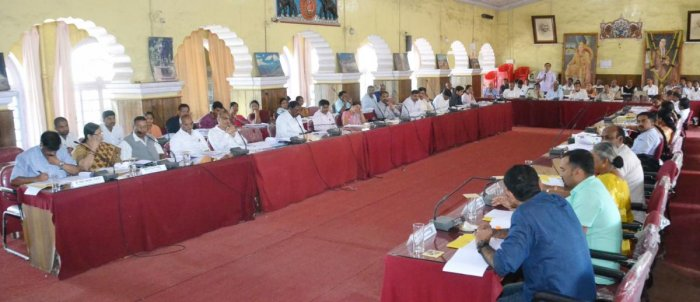 Elected representatives and officials take part in the KDP meeting at the Old Fort Hall in Madikeri on Tuesday.