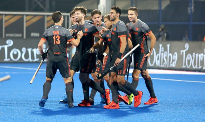 Dutch players celebrate after scoring against Canada.