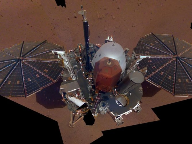 This is NASA InSight's first full selfie on Mars. It displays the lander's solar panels and deck. On top of the deck are its science instruments, weather sensor booms and UHF antenna. The selfie was taken on Dec. 6, 2018 (Sol 10). The selfie is made up of 11 images which were taken by its Instrument Deployment Camera, located on the elbow of its robotic arm. Those images are then stitched together into a mosaic.