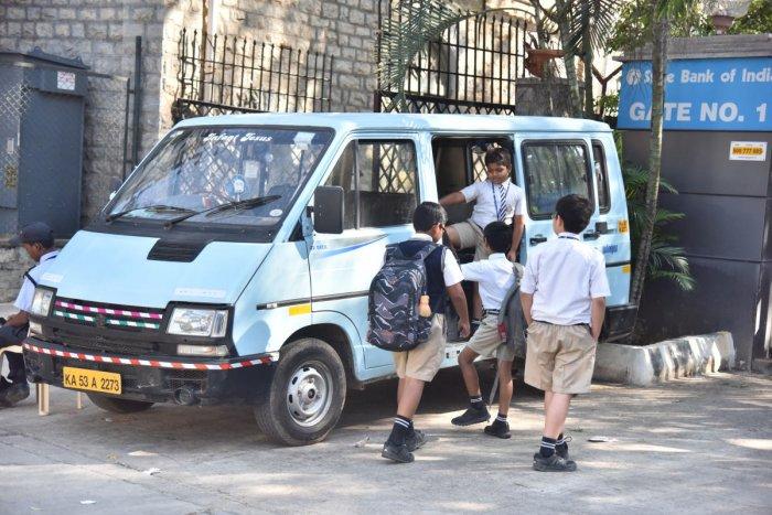 Children waiting by their private school van after school on Residency road in Bengaluru. DH Photo/Janardhan B K