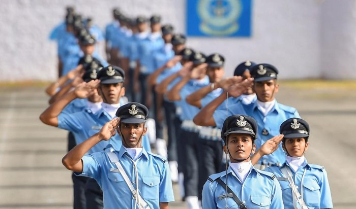 Bengaluru: New graduates of Indian Air Force's Aeronautical Engineers and Permanent Commissioned officers march during a passing out parade ceremony, in Bengaluru, Friday, Nov. 30, 2018. (PTI Photo/Shailendra Bhojak) (PTI11_30_2018_000062B)