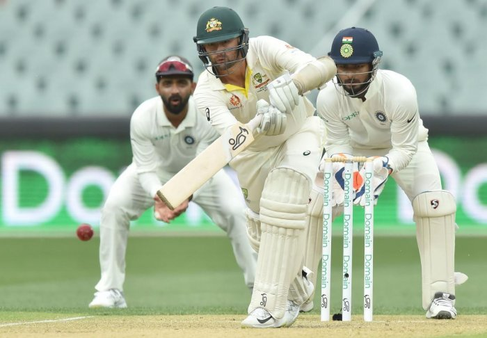 INSPIRING: Australian off-spinner Nathan Lyon showed great determination to slam an unbeaten 38 and almost take his side home in the first Test against India. AFP