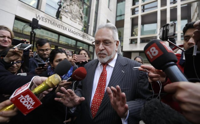 Indian businessman Vijay Mallya is surrounded by the media as he leaves Westminster Magistrates Court in London, Monday, Dec. 10, 2018. A British court has ordered that charismatic Indian tycoon Vijay Mallya should face extradition to India on financial f