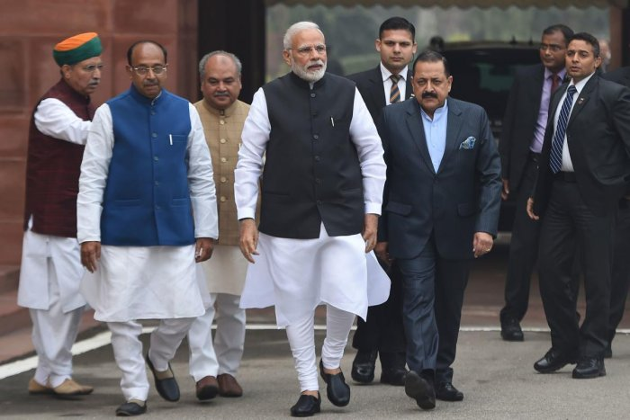 Prime Minister Narendra Modi walks upon his arrival for the winter session of parliament in New Delhi. AFP