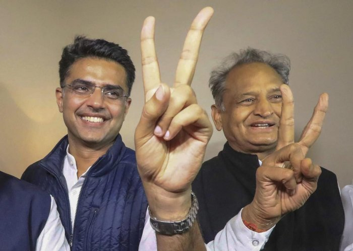 Congress leaders Sachin Pilot and Ashok Gehlot flash the victory sign after the declaration of Rajasthan Assembly election results in Jaipur on December 11. PTI