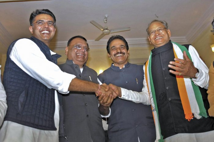 Former Rajasthan chief minister Ashok Gehlot (R), State Congress President Sachin Pilot (L), AICC general secretary KC Venugopal (second R) and Congress incharge for the state Avneesh Pandey greet each other after the party's win in the Assembly elections