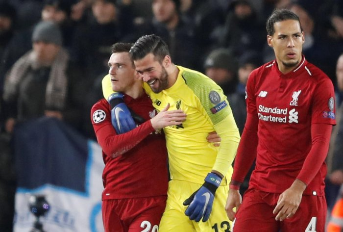 RELIEVED: Liverpool's goalkeeper Alisson celebrates with Andrew Robertson at the end of the match against Napoli. Reuters