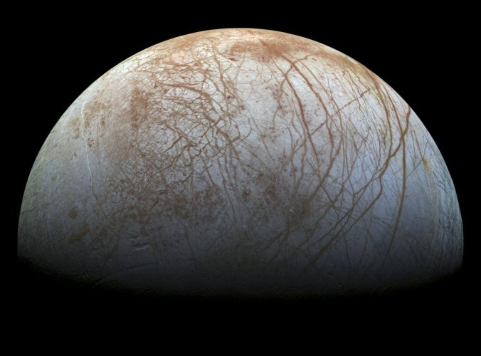 In a handout photo, the surface of Jupiter's icy moon Europa in a color view, made from images taken by NASA's Galileo spacecraft in the late 1990s. The Europa Clipper mission will sail past Jupiter's icy moon Europa on some 40 to 45 flybys sometime in the 2020s. (NASA/JPL-Caltech/Seti Institute)