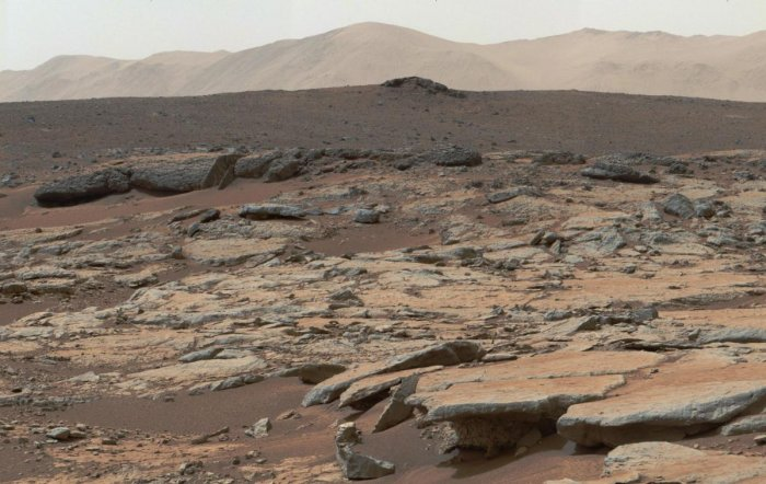 This December 09, 2013, NASA photo is a mosaic of images from NASA's Curiosity Mars rover and shows a series of sedimentary deposits in the Glenelg area of Gale Crater. NASA's rover Curiosity rover tooling around on the surface of Mars has found remnants