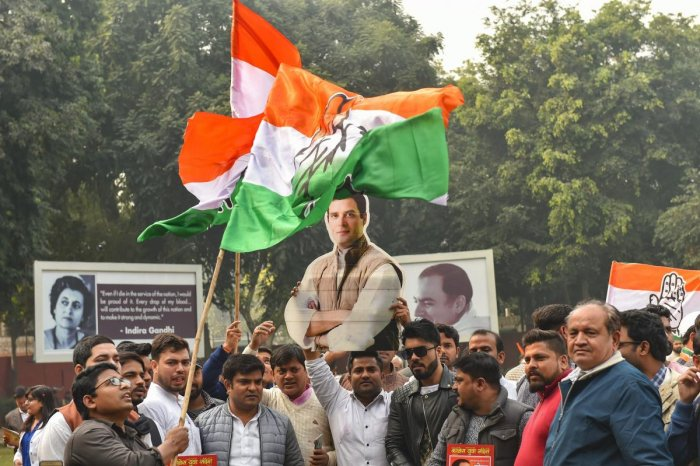 Congress party workers celebrate the party's good show in the Assembly elections of Rajasthan, Chhattisgarh and Madhya Pradesh, at AICC headquarters in New Delhi. PTI