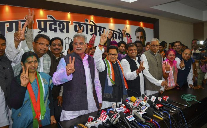 Congress in-charge of Chhattisgarh PL Punia flanked by party leaders display victory sign at a press conference after the party's win in the Assembly elections, in Raipur. PTI Photo