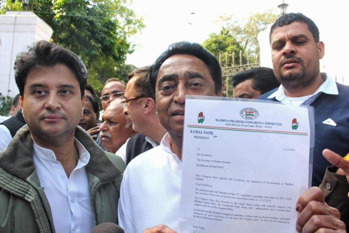 Madhya Pradesh Congress president Kamal Nath and party leader Jyotiraditya Scindia after meeting the governor to stake claim to form the government in Bhopal. PTI