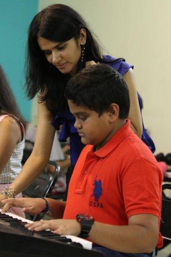Padmapriya HJ, keyboard teacher, with one of her students.