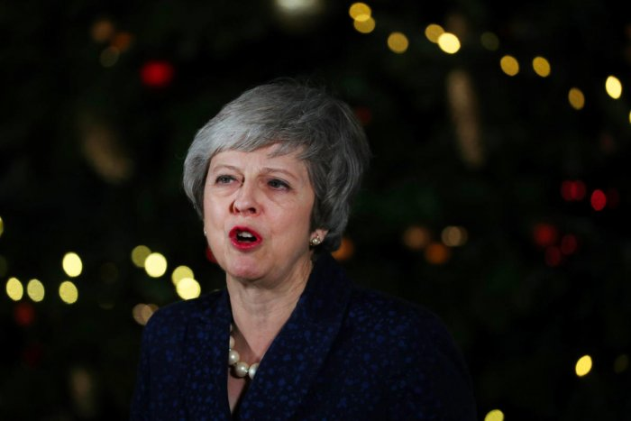 Britain's Prime Minister Theresa May speaks outside 10 Downing Street after a confidence vote by Conservative Party Members of Parliament (MPs), in London, Britain December 12, 2018. (REUTERS)